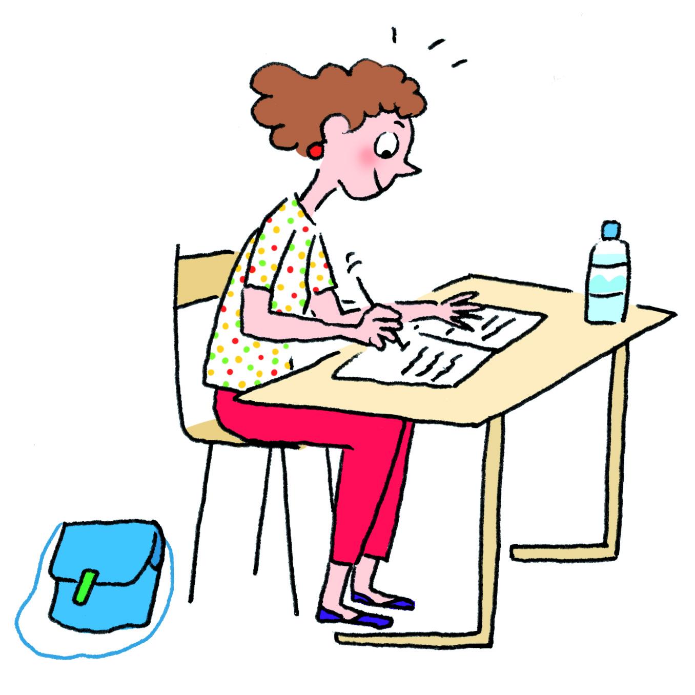 une jeune fille assise passant son brevet